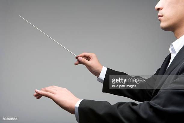 conducting - 指揮者 ストックフォトと画像