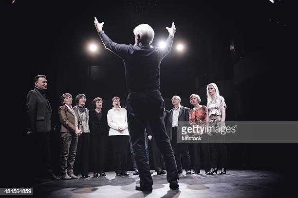 conductor and choir on stage - musical conductor stock pictures, royalty-free photos & images