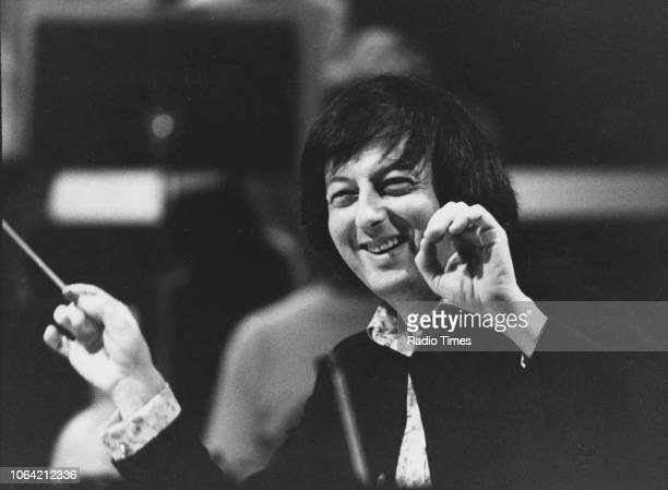 Conductor Andre Previn pictured at work with an orchestra April 30th 1975