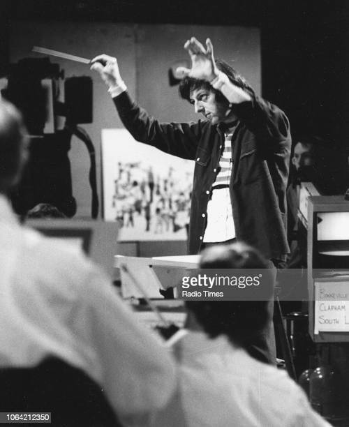 Conductor Andre Previn pictured at work with an orchestra photographed for Radio Times in connection with the BBC television show 'Andre Previn's...