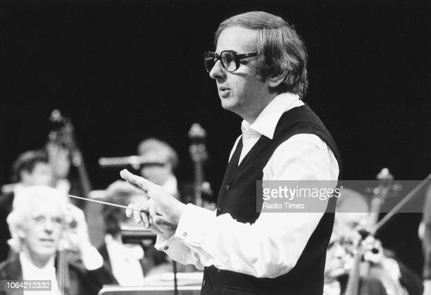 Conductor Andre Previn pictured with an orchestra October 29th 1983
