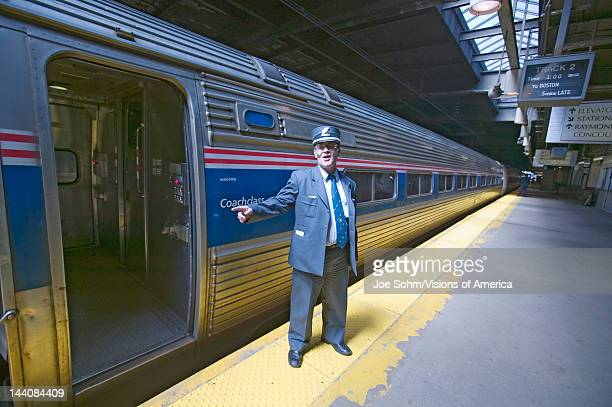 Conductor at Amtrak train platform announces All Aboard at East Coast train station on the way to New York City New York Manhattan New York