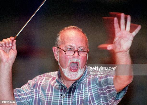 Conductor Bill Hall rehearses about 700 mixed choir and symphony members Monday evening for the Behemoth Mahler performance this weekend at the...