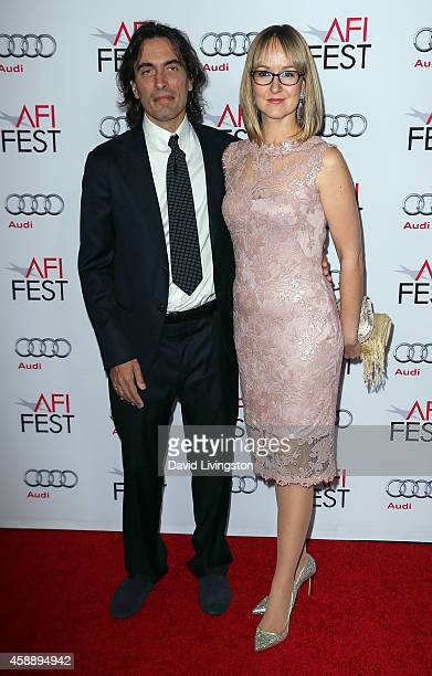 Conductor Carlo Ponti Jr and wife violinist Andrea Meszaros Ponti attend the AFI FEST 2014 presented by Audi's special tribute to Sophia Loren at the...