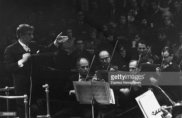 Conductor composer and pianist Leonard Bernstein conducting the New York Philharmonic orchestra