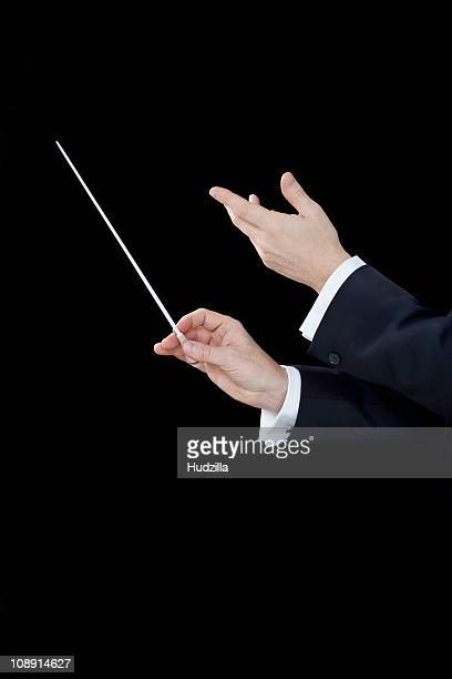 a conductor conducting, focus on hands - conductor's baton stock photos and pictures