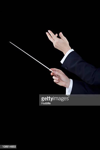 A conductor conducting, focus on hands