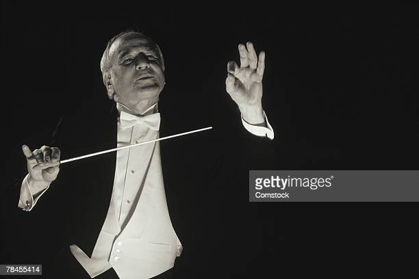 Conductor conducting symphony