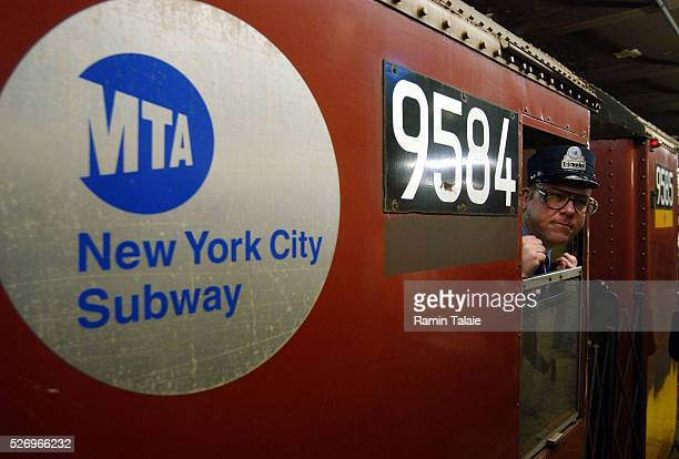 Conductor Daniel Wrynn checks for passengers on the platform as the train pulls away The New York City Metropolitan Transit Authority retired the...