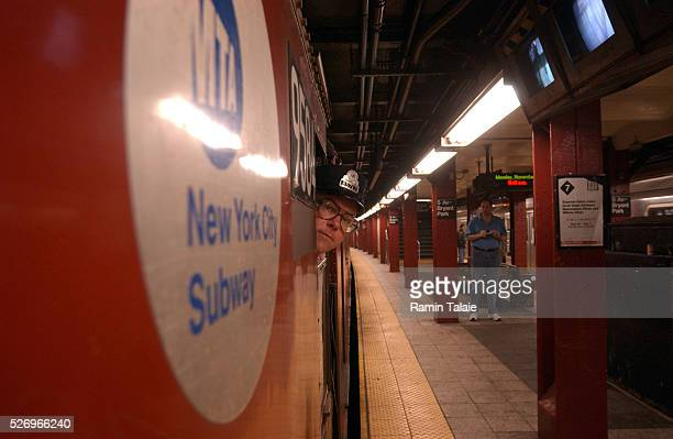 Conductor Daniel Wrynn checks the platform as the train pulls away The New York City Metropolitan Transit Authority retired the last of their oldest...