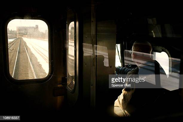 A conductor drives an Amtrak train on February 8 2011 outside of Newark New Jersey Amtrak a governmentowned corporation has joined up with New...