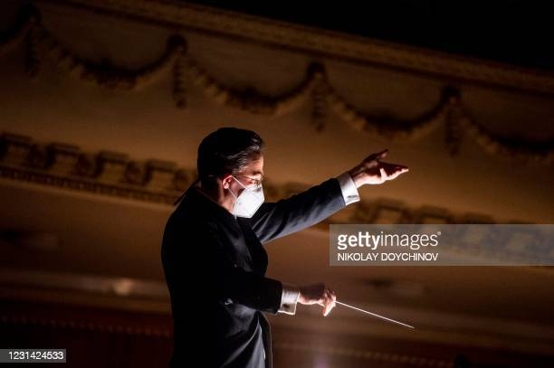 Conductor Evan Alexis Christ wearing a protective face mask conducts the Sofia Opera orchestra during the opera La Traviata by Italian composer...