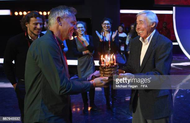 Conductor Gary Lineker receives a birthday cake by Gordon Banks prior to the 2018 FIFA World Cup Draw the 2018 FIFA World Cup Draw at the Draw hall...