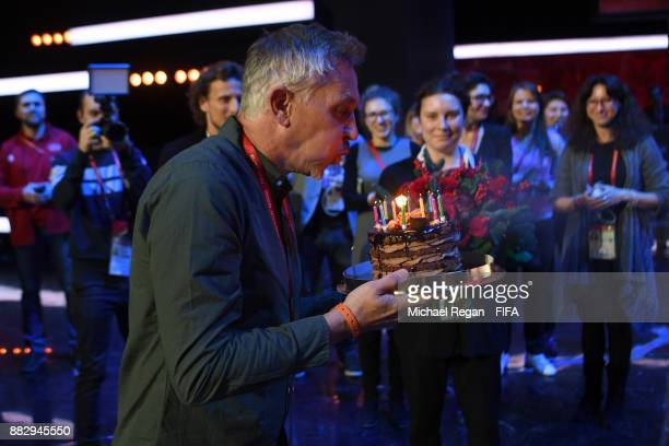 Conductor Gary Lineker receives a birthday cake prior to the 2018 FIFA World Cup Draw the 2018 FIFA World Cup Draw at the Draw hall on November 30...