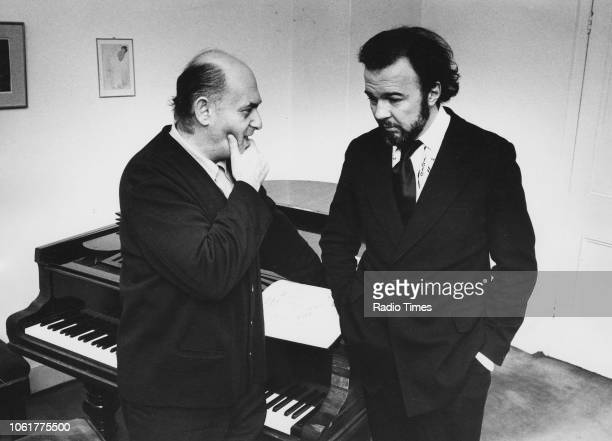 Conductor George Solti and theatre director Peter Hall pictured in conversation next to a piano, January 29th 1971.