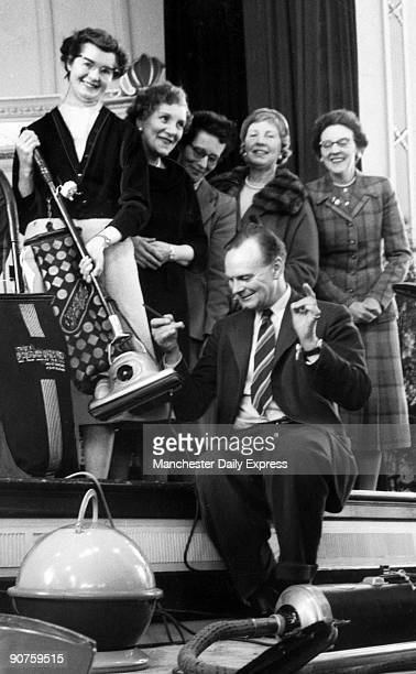 Conductor George Weldon of the Halle Orchestra listens to domestic appliances in preparation for a ?Grand, Grand Overture? to be held in honour of...