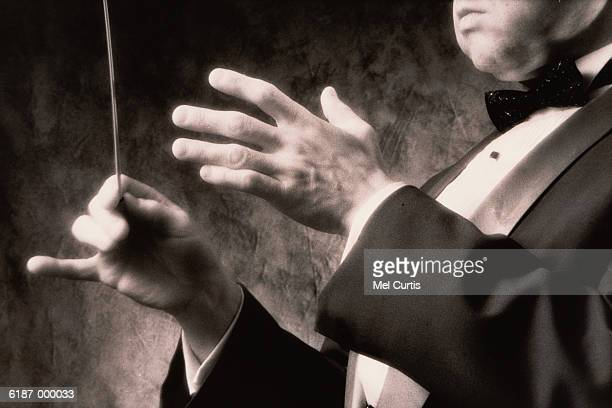 Conductor Holding Baton