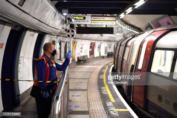 TFL conductor is seen wearing a protective mask at Embankment station on May 16 2020 in London England The prime minister announced the general...