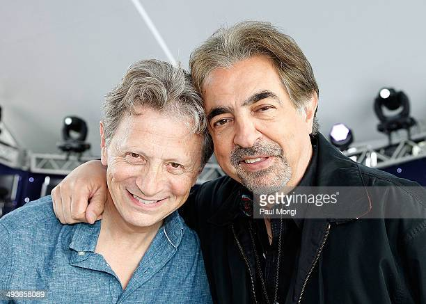 Conductor Jack Everly poses for a photo with hosts Joe Mantegna at the 25th National Memorial Day Concert rehearsals at US Capitol West Lawn on May...