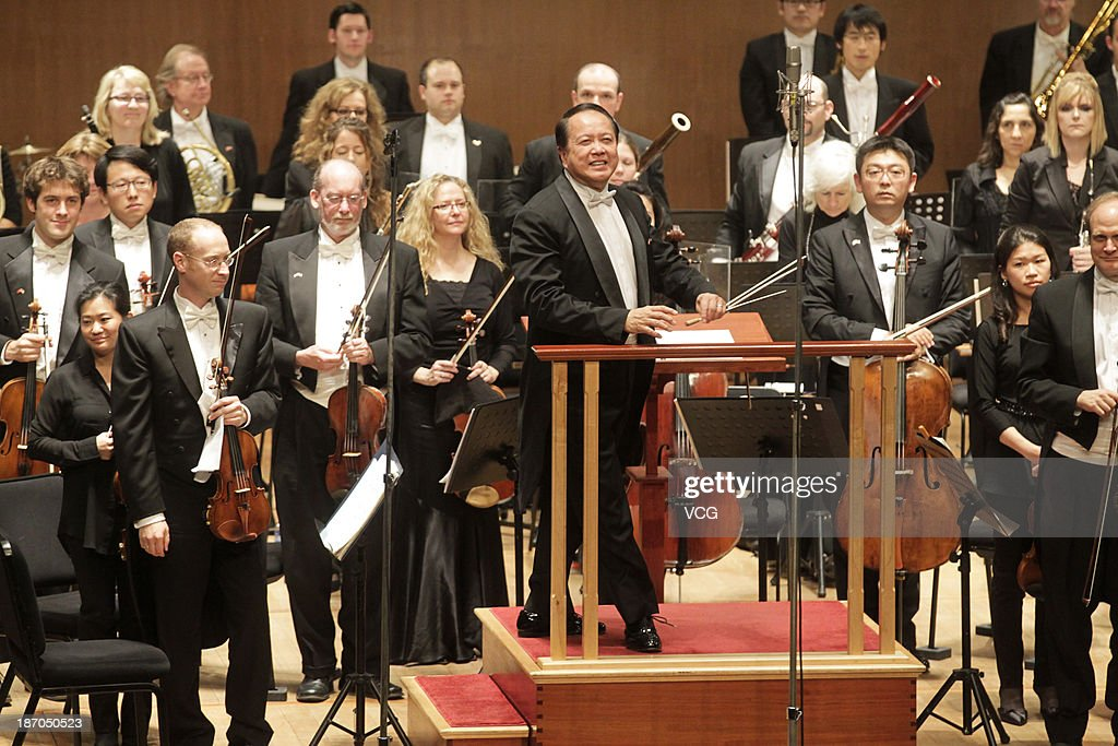 Conductor Jahja Ling (C) with the San Diego Symphony perform on the stage in concert at Shanghai Oriental Art Center on November 5, 2013 in Shanghai, China.