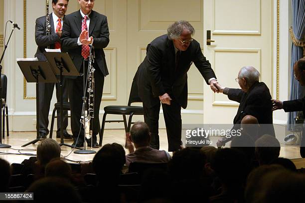 Conductor James Levine congratulates American composer Elliott Carter after the Met Chamber Ensemble performed Carter's 'Tempo e Tempi' at Weill...