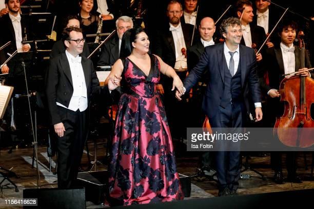 Conductor Jochen Rieder opera singer Anita Rachvelishvili and opera singer Jonas Kaufmann live on stage during the Thurn Taxis Castle Festival 2019...