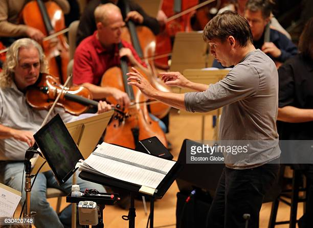 Conductor Keith Lockhart leads the Boston Pops Orchestra through a rehearsal at Symphony Hall in Boston on Oct 27 2015 The program is a live score...