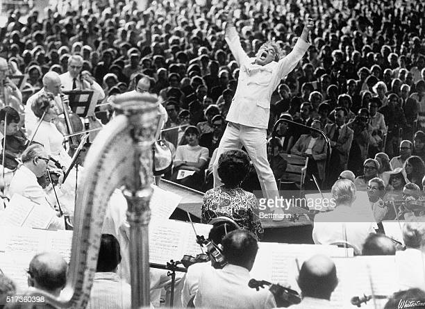 Conductor Leonard Bernstein at the climax of Mahler's Resurrection symphony performed by the Boston Symphony in Lenox Massachusetts
