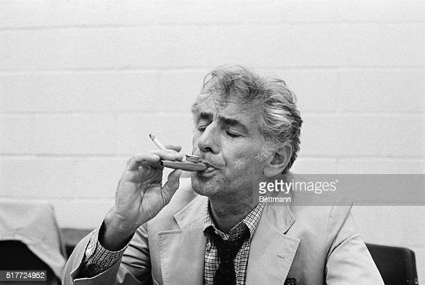 """Conductor Leonard Bernstein plays a kazoo during a rehearsal of """"Mass"""" at the John F. Kennedy Center for the Performing Arts. A scene from """"Mass,""""..."""