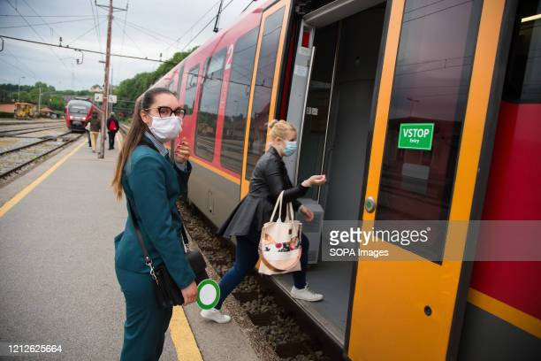 Conductor looks on while wearing a face mask as a preventive measure as public transportation resumes in Slovenia. Public transport in Slovenia...