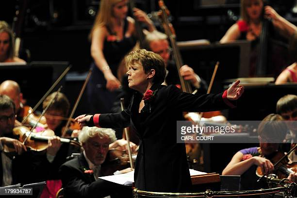 US conductor Marin Alsop conducts the orchestra at the Royal Albert Hall in west London on September 7 2013 during the Last Night of the Proms Marin...