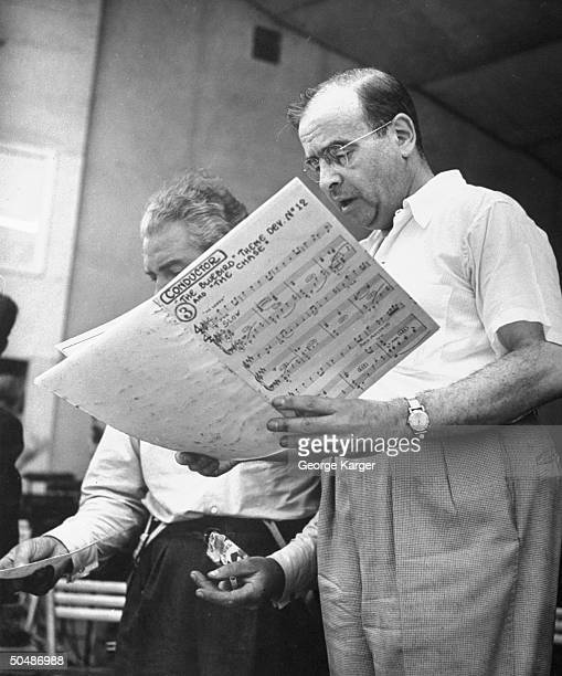 Conductor Max Steiner discussing the score for singer Frank Sinatra's songs The Bluebird and The Chase w his assist during rehearsal for the crooner...