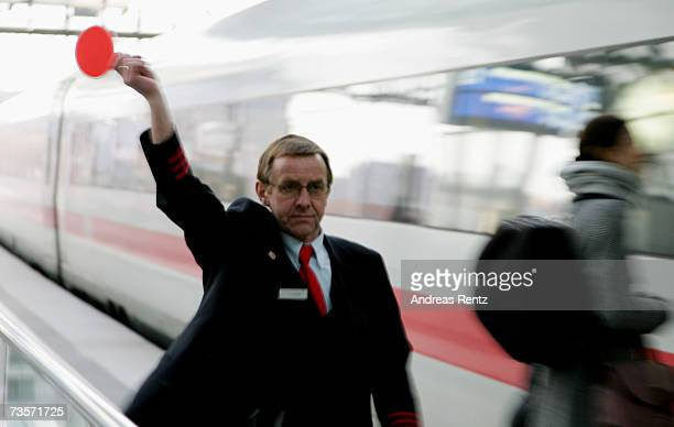 A conductor of Deutsche Bahn dispatches a train at Berlin Central Station on February 6 2007 in Berlin Germany Germany is currently in a heated...