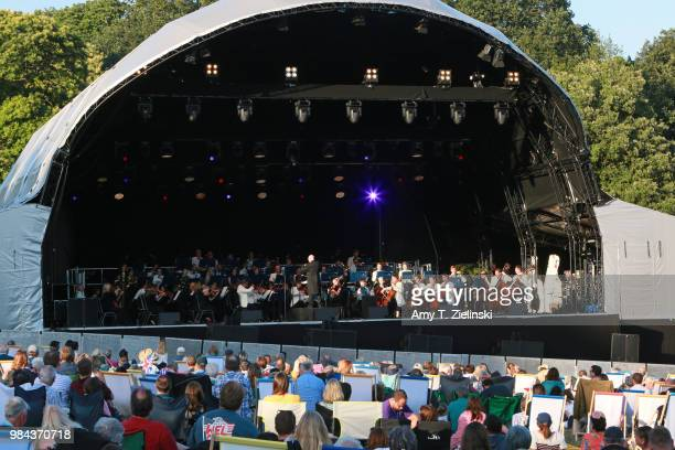 Conductor Paul Bateman leads the Royal Philharmonic Concert Orchestra during The Heritage Live Concert Series on stage at Kenwood House on June 24,...