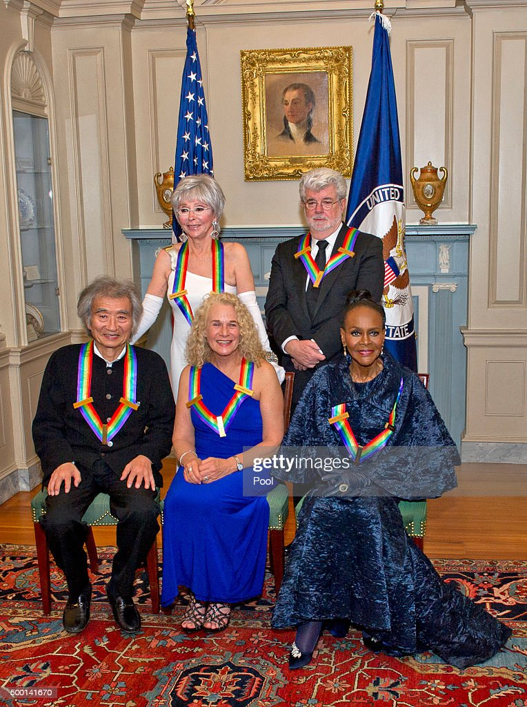 Conductor Seiji Ozawa, actress and singer Rita Moreno, singer-songwriter Carole King, filmmaker George Lucas, and actress and Broadway star Cicely Tyson pose for a group photo following a dinner hosted by United States Secretary of State John F. Kerry in their honor at the U.S. Department of State in Washington, D.C. on Saturday, December 5, 2015. The 2015 honorees are: singer-songwriter Carole King, filmmaker George Lucas, actress and singer Rita Moreno, conductor Seiji Ozawa, and actress and Broadway star Cicely Tyson.