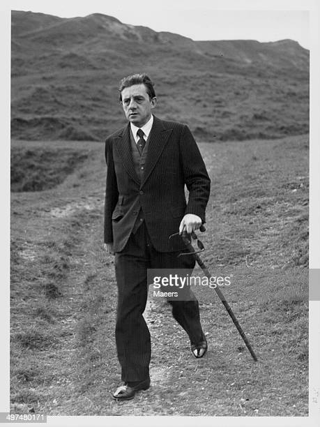 Conductor Sir John Barbirolli taking a stroll in the Cotswolds at Cleeve Hill, July 7th 1951.