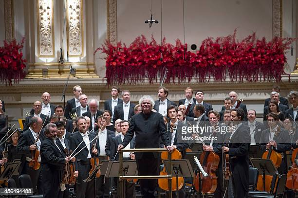 Conductor Sir Simon Rattle leads the Berliner Philharmoniker Orchestra at Carnegie Hall's Opening Night Gala on October 1 2014 in New York City