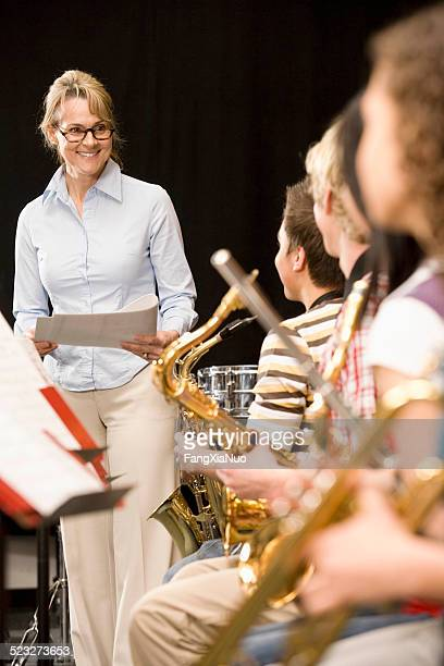 Conductor smiling at high-school music class