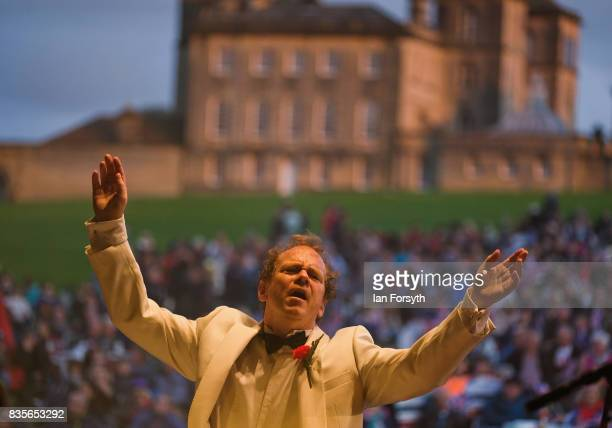 Conductor Stephen Ellery conducts the London Gala Orchestra during the annual Castle Howard Proms Spectacular concert held on the grounds of the...