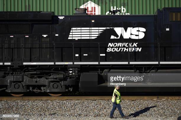 A conductor walks past a Norfolk Southern Corp freight locomotive during a crew change in Burnside Kentucky US on Tuesday Oct 17 2017 Norfolk...