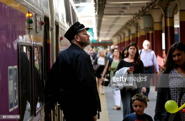 A conductor watches commuters board a train at South Station in Boston on Aug 31 2017 Beginning soon a small army of ticket police will fan out at...