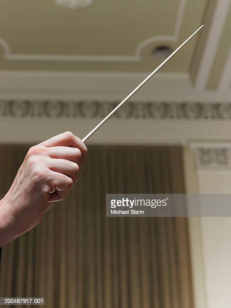 conductor with baton, close-up - conductor's baton stock photos and pictures