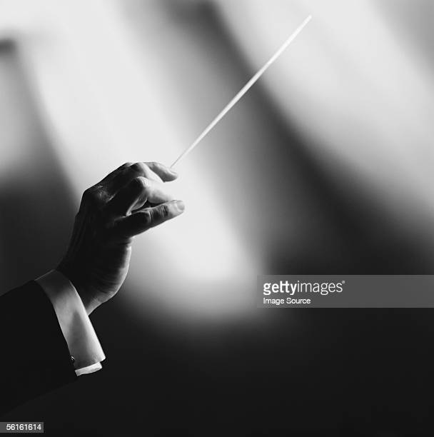 conductor with baton - maestro stock photos and pictures