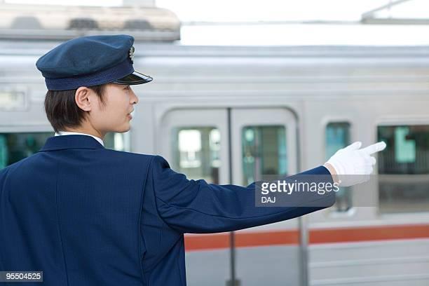 Conductor working at platform