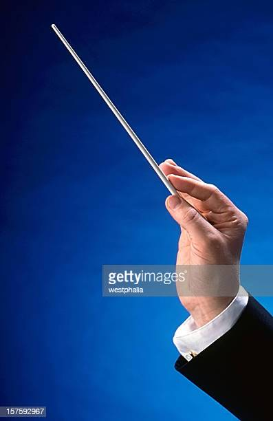 conductor's hand - conductor's baton stock photos and pictures