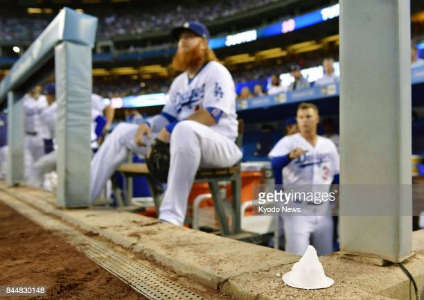 A cone of salt an item traditionally used in Japan to ward off bad luck is placed in front of the bench of the Los Angeles Dodgers ahead of a game...