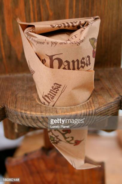 cone of toasted almonds from olde hansa. - harjumaa stock pictures, royalty-free photos & images