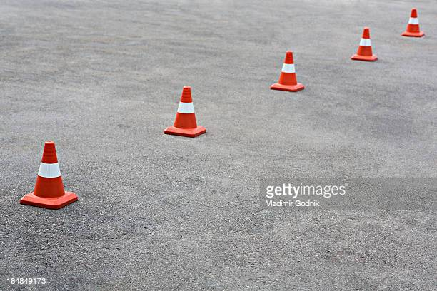 cones on tarmac - traffic cone stock pictures, royalty-free photos & images