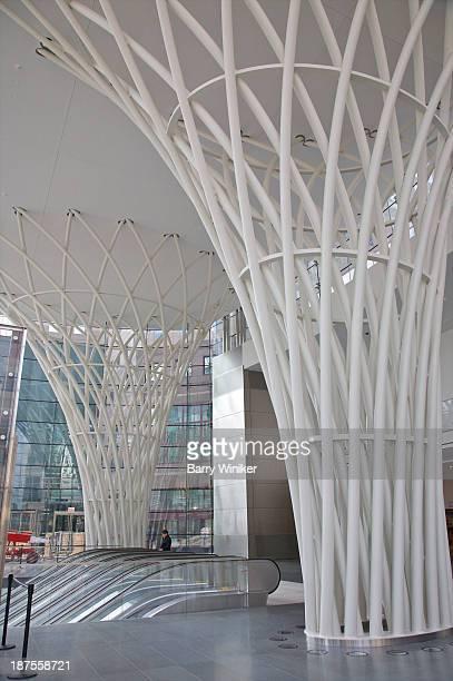 Cone-shaped white pipe columns in new atrium