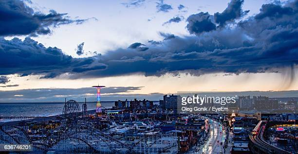 coney island against sky during sunset in city - coney island stock pictures, royalty-free photos & images